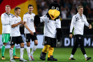 STUTTGART, GERMANY - SEPTEMBER 04: Bernd Leno (L-R), Joshua Kimmich, Leon Goretzka, mascot Paule and Matthias Ginter of Germany celebrate after the FIFA 2018 World Cup Qualifier between Germany and Norway at Mercedes-Benz Arena on September 4, 2017 in Stuttgart, Baden-Wuerttemberg. (Photo by Maja Hitij/Bongarts/Getty Images)