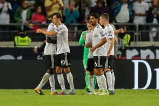 STUTTGART, GERMANY - SEPTEMBER 04: Antonio Ruediger of Germany Sami Khedira of Germany Leon Goretzka of Germany Julian Draxler of Germany celebrate their win during the FIFA 2018 World Cup Qualifier between Germany and Norway at Mercedes-Benz Arena on September 4, 2017 in Stuttgart, Baden-Wuerttemberg. (Photo by TF-Images/TF-Images via Getty Images)