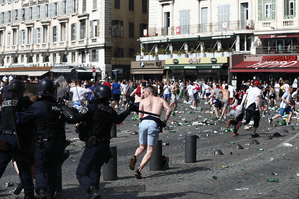 MARSEILLE, FRANCE - JUNE 11:  Police clash with England fans ahead of the game against Russia later today on June 11, 2016 in Marseille, France.  Football fans from around Europe have descended on France for the UEFA Euro 2016 football tournament.  (Photo by Carl Court/Getty Images)