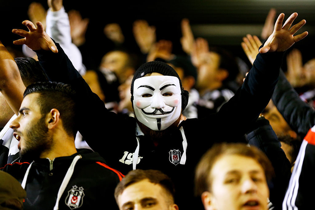 LIVERPOOL, ENGLAND - FEBRUARY 19:  A Besiktas fan cheers on his team during the UEFA Europa League Round of 32 match between Liverpool FC and Besiktas JK at Anfield on February 19, 2015 in Liverpool, United Kingdom.  (Photo by Julian Finney/Getty Images)