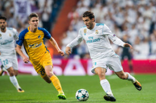 MADRID, SPAIN - SEPTEMBER 13: Mateo Kovacic (r) of Real Madrid is tackled by Roland Sallai of APOEL FC during the UEFA Champions League 2017-18 match between Real Madrid and APOEL FC at Estadio Santiago Bernabeu on 13 September 2017 in Madrid, Spain. (Photo by Power Sport Images/Getty Images)