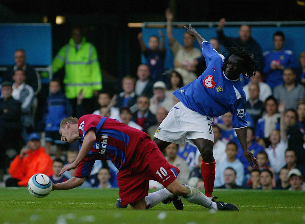 PORTSMOUTH, ENGLAND - SEPTEMBER 11: Crystal Palaces Sandor Torghelle is bought down in the box during the Barclays Premiership match between Portsmouth and Crystal Palace at Fratton Park on September 11, 2004 in Portsmouth, England.  (Photo by Jo Caird/Getty Images)