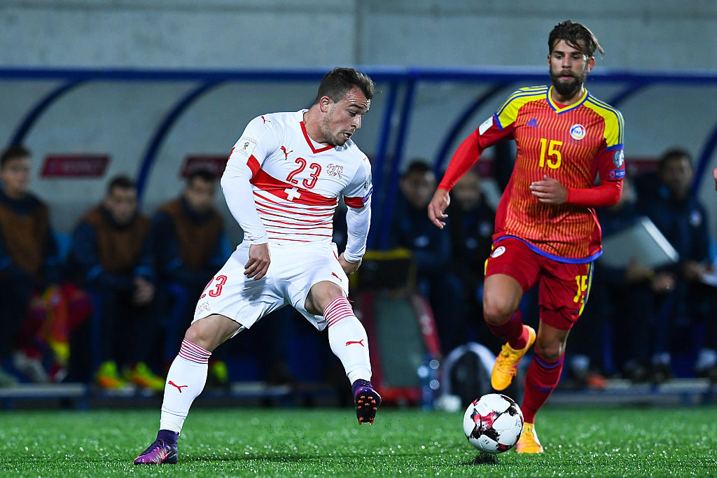 ANDORRA LA VELLA, ANDORRA - OCTOBER 10:  Xherdan Shaqiri of Switzerland competes for the ball with Moises San Nicolas of Andorra during the FIFA 2018 World Cup Qualifier between Andorra and Switzerland at Estadi Nacional on October 10, 2016 in Andorra la Vella, Andorra.  (Photo by David Ramos/Getty Images)