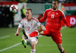 BUDAPEST, HUNGARY - OCTOBER 7: Adam Lang #2 of Hungary fights for the ball with Eren Derdiyok #19 of Switzerland during the FIFA 2018 World Cup Qualifier match between Hungary and Switzerland at Groupama Arena on October 7, 2016 in Budapest, Hungary. (Photo by Laszlo Szirtesi/Getty Images)