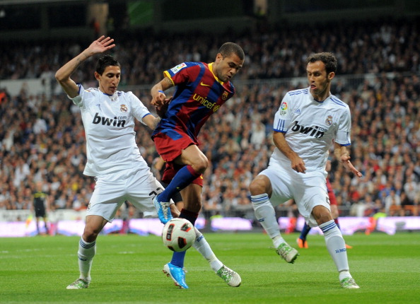 MADRID, SPAIN - APRIL 16: Dani Alves (C) of Barcelona is tackled by Marcelo (L) and Ricardo Carvalho of Real Madrid during the La Liga match between Real Madrid and Barcelona at Estadio Santiago Bernabeu on April 16, 2011 in Madrid, Spain.  (Photo by Denis Doyle/Getty Images)