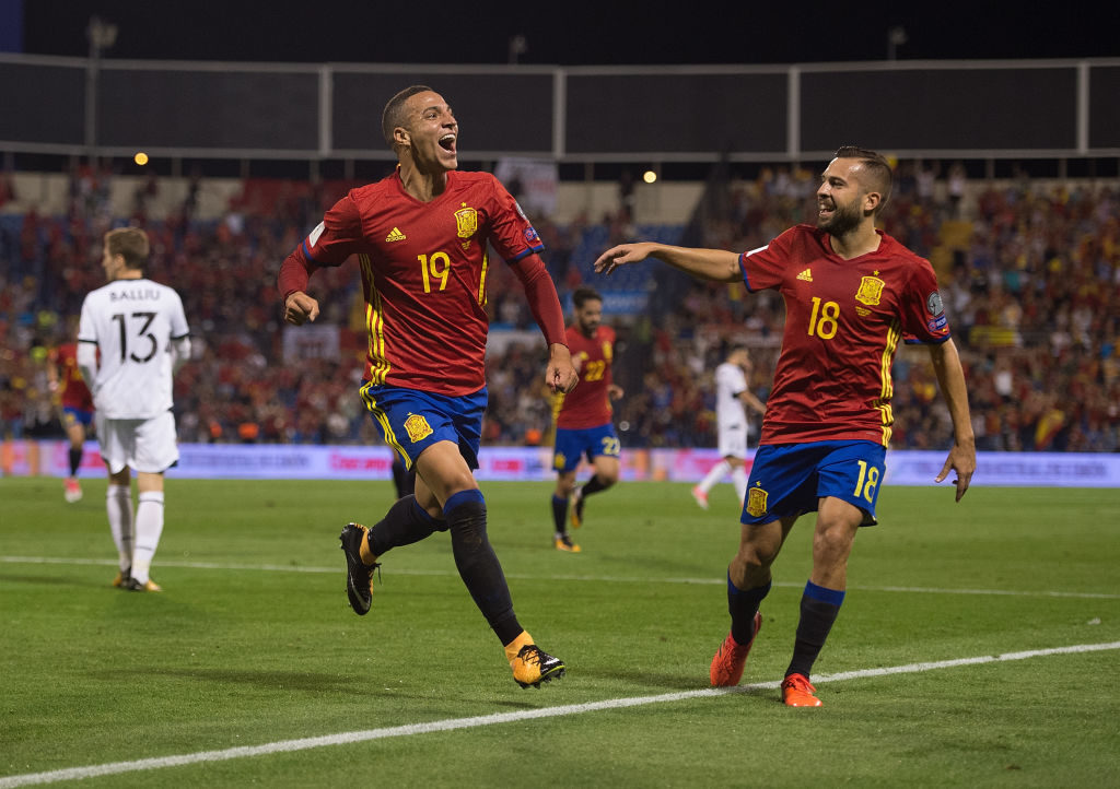 ALICANTE, SPAIN - OCTOBER 06: Rodrigo of Spain celebrates its Jordi Alba of Spain after scoring Spain opening goal during the FIFA 2018 World Cup Qualifier between Spain and Albania at Estadio Jose Rico Perez on October 6, 2017 in Alicante, Spain. (Photo by Denis Doyle/Getty Images)
