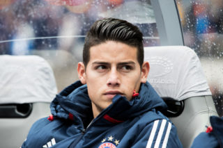 BERLIN, GERMANY - OCTOBER 01:  James Rodriguez of FC Bayern Muenchen sits on the bench prior to the Bundesliga match between Hertha BSC and FC Bayern Muenchen at Olympiastadion on October 1, 2017 in Berlin, Germany.  (Photo by Boris Streubel/Getty Images)