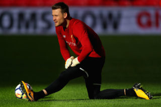 LONDON, ENGLAND - OCTOBER 22: Simon Mignolet of Liverpool warms up prior to the Premier League match between Tottenham Hotspur and Liverpool at Wembley Stadium on October 22, 2017 in London, England.  (Photo by Richard Heathcote/Getty Images)
