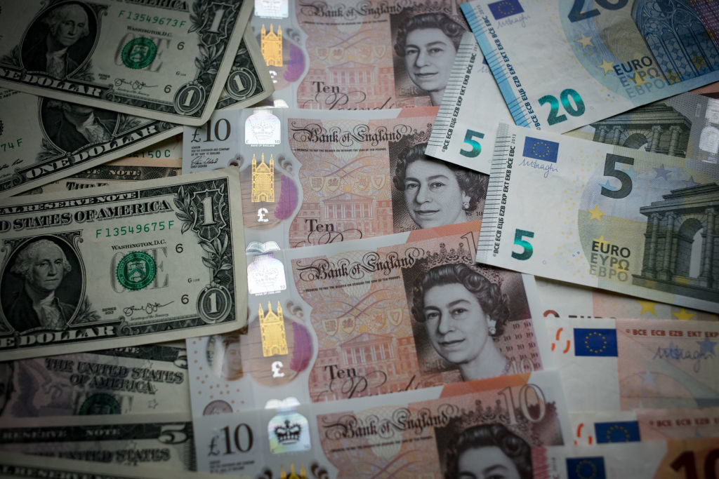 BATH, ENGLAND - OCTOBER 13:  In this photo illustration, the new £10 note is seen alongside euro notes and US dollar bills on October 13, 2017 in Bath, England. Currency experts have warned that as the uncertainty surrounding Brexit continues, the value of the British pound, which has remained depressed against the US dollar and the euro since the UK voted to leave in the EU referendum, is likely to fluctuate.  (Photo Illustration by Matt Cardy/Getty Images)
