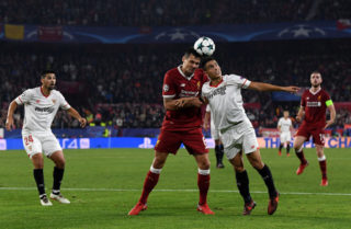 SEVILLE, SPAIN - NOVEMBER 21:  Wissam Ben Yedder of Sevilla and Dejan Lovren of Liverpool battle for possesion during the UEFA Champions League group E match between Sevilla FC and Liverpool FC at Estadio Ramon Sanchez Pizjuan on November 21, 2017 in Seville, Spain.  (Photo by David Ramos/Getty Images)