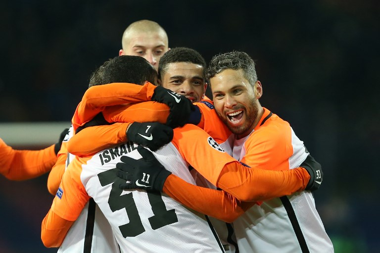 Shakhtar Donetsk's Brazilian defender Ismaily (L) celebrate with his teammates after scoring a goal Shakhtar Donetsk's Brazilian midfielder Taison Barcellos Freda (C) and Shakhtar Donetsk's Brazilian midfielder Marlos (R) during the UEFA Champions League group F football match between Shakhtar Donetsk and Manchester City, on December 6, 2017, at the Metalist stadium in Kharkiv, Eastern Ukraine. / AFP PHOTO / Stanislas VEDMID