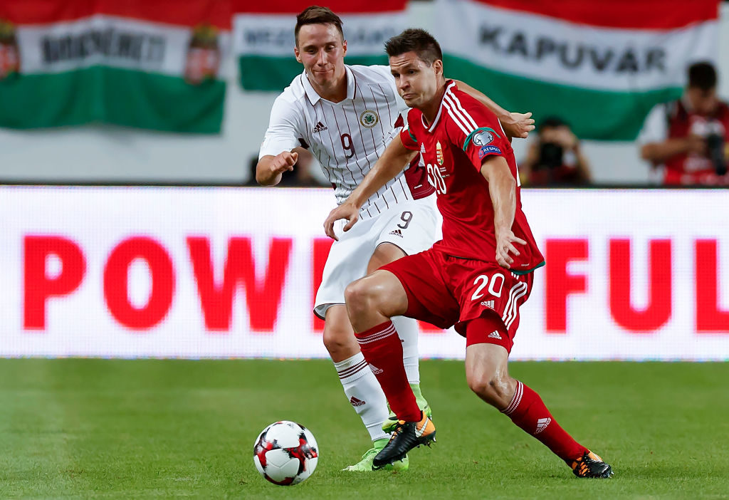 BUDAPEST, HUNGARY - AUGUST 31: Richard Guzmics #20 of Hungary competes for the ball with Davis Ikaunieks #9 of Latvia during the FIFA 2018 World Cup Qualifier match between Hungary and Latvia at Groupama Arena on August 31, 2017 in Budapest, Hungary. (Photo by Laszlo Szirtesi/Getty Images)