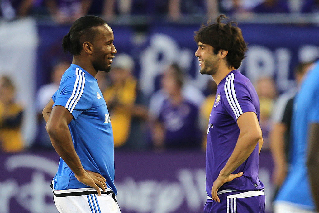 ORLANDO, FL - OCTOBER 03:  Didier Drogba #11 of Montreal Impact (L) chats with Kaka #10 of Orlando City SC prior to a MLS soccer match between the Montreal Impact and the Orlando City SC at the Orlando Citrus Bowl on October 3, 2015 in Orlando, Florida. (Photo by Alex Menendez/Getty Images)