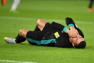 ABU DHABI, UNITED ARAB EMIRATES - DECEMBER 13:  Cristiano Ronaldo of Real Madrid lies injured during the FIFA Club World Cup UAE 2017 semi-final match between Al Jazira and Real Madrid  on December 13, 2017 in Abu Dhabi, United Arab Emirates.  (Photo by Etsuo Hara/Getty Images)