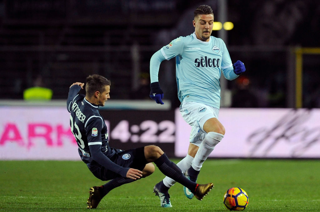 BERGAMO, ITALY - DECEMBER 17:  Sergej Milinkovic Savic of SS Lazio  compete for the ball with Hans Hetebor of Atalanta BC during the Serie A match between Atalanta BC and SS Lazio at Stadio Atleti Azzurri d'Italia European Short Course Swimming Championships on December 17, 2017 in Bergamo, Italy.  (Photo by Marco Rosi/Getty Images)