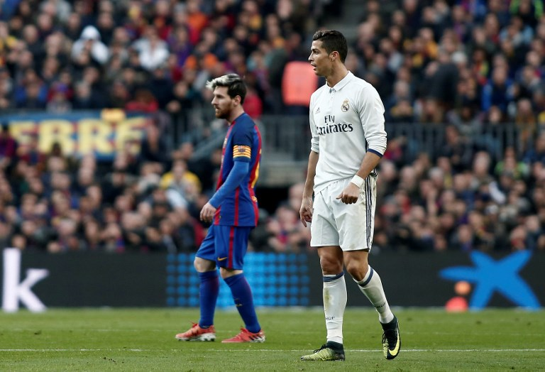 BARCELONA, SPAIN - DECEMBER 03 : Cristiano Ronaldo (R) of Real Madrid and Lionel Messi (L) of Barcelona are seen during the La Liga football match between FC Barcelona and Real Madrid CF at Camp Nou Stadium in Barcelona, Spain on December 03, 2016. Burak Akbulut / Anadolu Agency