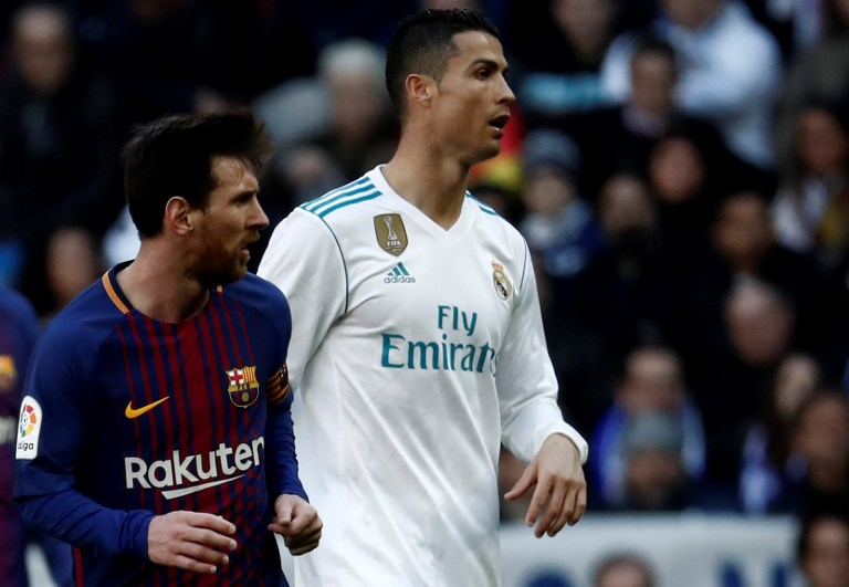 MADRID, SPAIN - DECEMBER 23: Cristiano Ronaldo (R) of Real Madrid and Lionel Messi (L) of Barcelona are seen during the La Liga match between Real Madrid and Barcelona at Santiago Bernabeu Stadium in Madrid, Spain on December 23, 2017. Burak Akbulut / Anadolu Agency