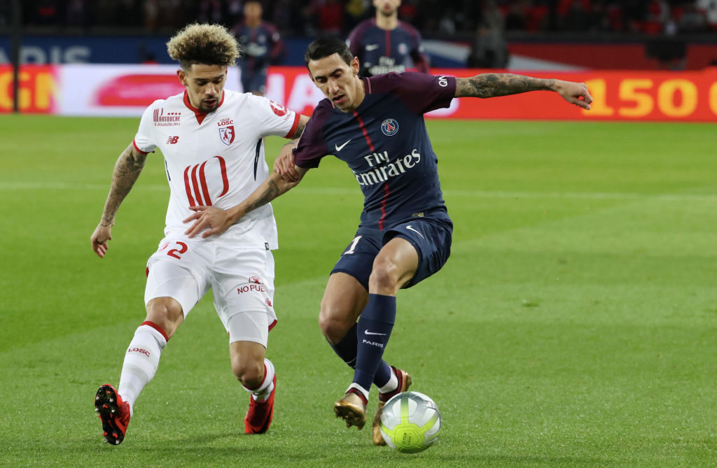 PARIS, FRANCE - DECEMBER 09: Kevin Malcuit of Lille OSC in action with Angel Di Maria of Paris Saint-Germain during the Ligue 1 match between Paris Saint Germain (PSG) and Lille OSC at Parc des Princes on December 9, 2017 in Paris. (Photo by Xavier Laine/Getty Images)
