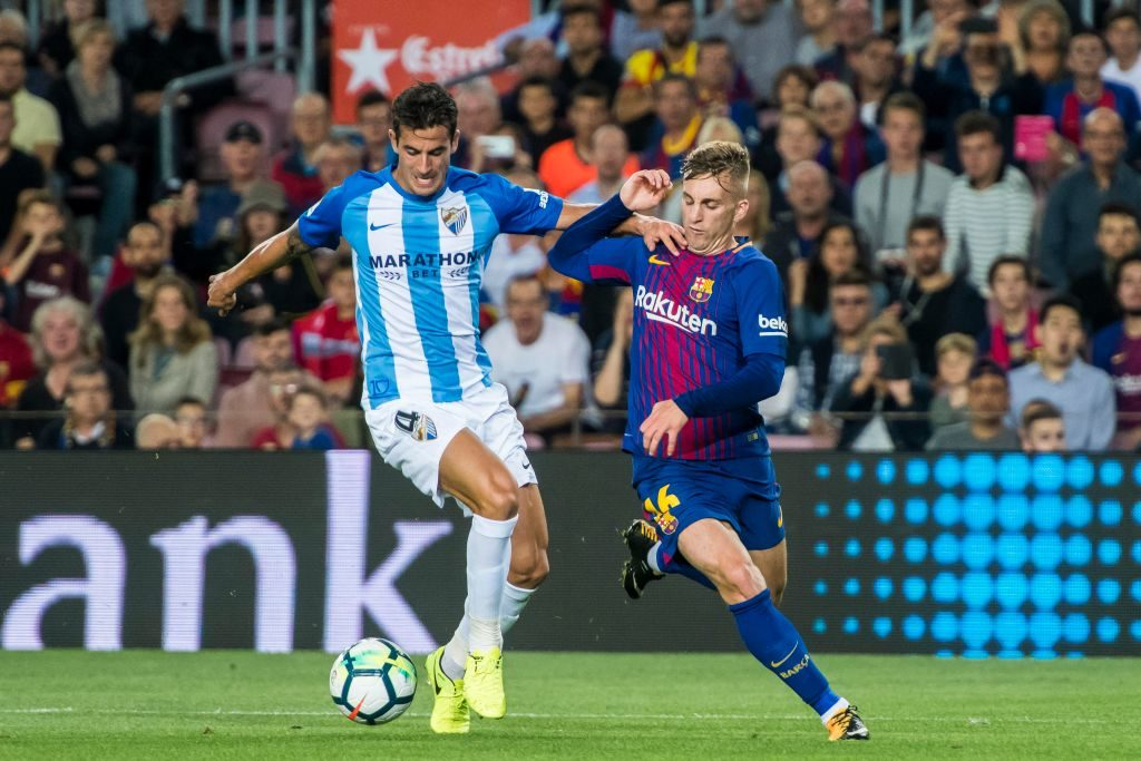 BARCELONA, SPAIN - OCTOBER 21: Gerard Deulofeu Lazaro (r) of FC Barcelona battles for the ball with , Luis Hernandez Rodriguez of Malaga CF during the La Liga 2017-18 match between FC Barcelona and Malaga CF at Camp Nou on 21 October 2017 in Barcelona, Spain. (Photo by Power Sport Images/Getty Images)