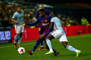 VIGO, SPAIN - JANUARY 04:  Nelson Semedo of FC Barcelona is challenged by Pione Sisto of Celta de Vigo during the Copa del Rey, Round of 16, first Leg match between Celta de Vigo and FC Barcelona at Estadio de Balaidos on January 4, 2018 in Vigo, Spain.  (Photo by fotopress/Getty Images)