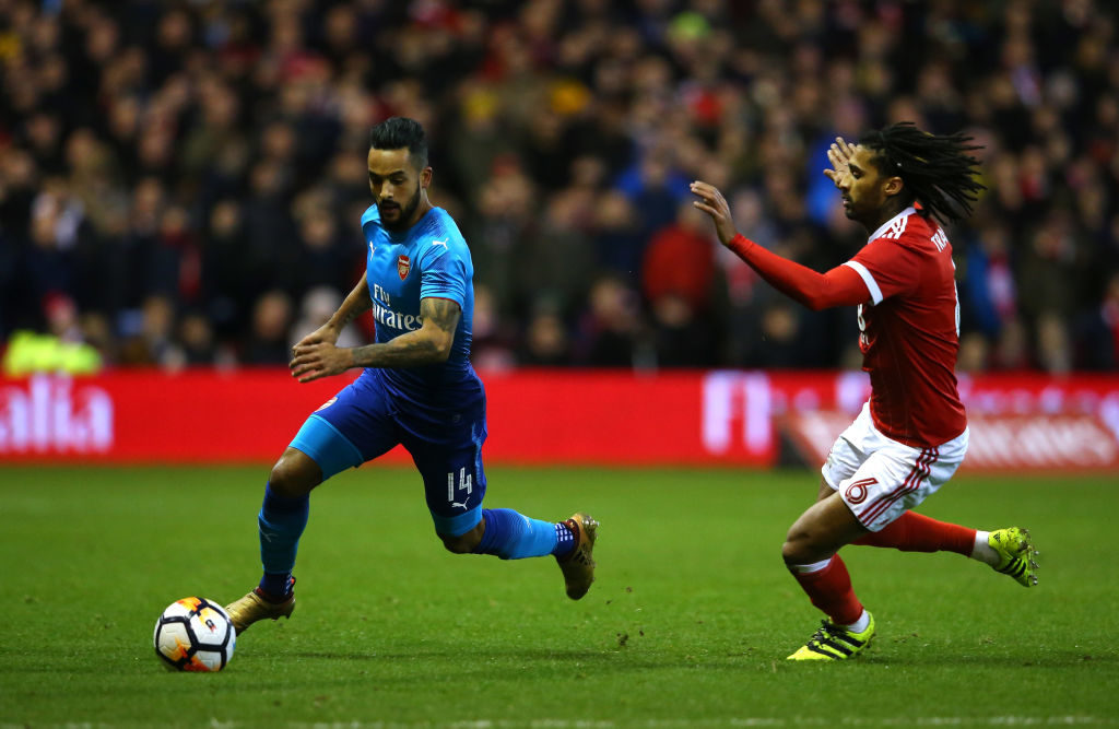 NOTTINGHAM, ENGLAND - JANUARY 07:  Theo Walcott of Arsenal beats Armand Traore of Nottingham Forest during the Emirates FA Cup Third Round match between Nottingham Forest and Arsenal at City Ground on January 7, 2018 in Nottingham, England.  (Photo by Alex Livesey - Danehouse/Getty Images)