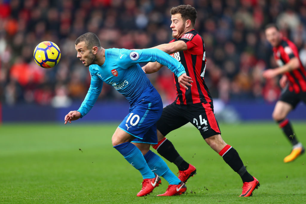 BOURNEMOUTH, ENGLAND - JANUARY 14:  Jack Wilshere of Arsenal and Ryan Fraser of AFC Bournemouth battles for possesion during the Premier League match between AFC Bournemouth and Arsenal at Vitality Stadium on January 14, 2018 in Bournemouth, England.  (Photo by Clive Rose/Getty Images)