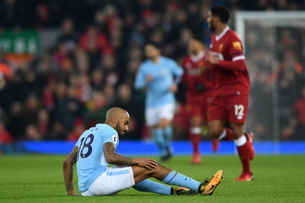 LIVERPOOL, ENGLAND - JANUARY 14:  Fabian Delph of Manchester City lies injured during the Premier League match between Liverpool and Manchester City at Anfield on January 14, 2018 in Liverpool, England.  (Photo by Shaun Botterill/Getty Images)