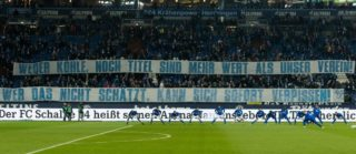 GELSENKIRCHEN, GERMANY - JANUARY 21: Supporters of Schalke are seen with banners prior to the Bundesliga match between FC Schalke 04 and Hannover 96 at Veltins-Arena on January 21, 2018 in Gelsenkirchen, Germany. (Photo by TF-Images/TF-Images via Getty Images)
