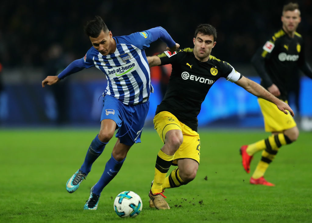 xxx is challenged by yyy during the Bundesliga match between Hertha BSC and Borussia Dortmund at Olympiastadion on January 19, 2018 in Berlin, Germany.