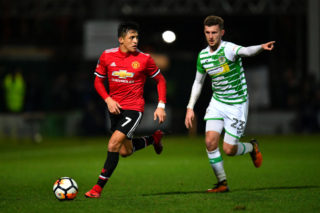 YEOVIL, ENGLAND - JANUARY 26:  Alexis Sanchez of Manchester United and Tom James of Yeovil Town during The Emirates FA Cup Fourth Round match between Yeovil Town and Manchester United at Huish Park on January 26, 2018 in Yeovil, England.  (Photo by Dan Mullan/Getty Images)