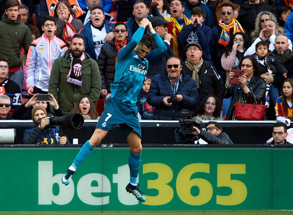 VALENCIA, SPAIN - JANUARY 27:  Cristiano Ronaldo of Real Madrid celebrates after scoring his sides first goal during the La Liga match between Valencia and Real Madrid at Estadio Mestalla on January 27, 2018 in Valencia, Spain.  (Photo by Quality Sport Images/Getty Images)