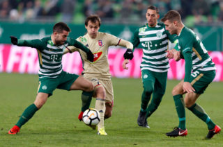 BUDAPEST, HUNGARY - DECEMBER 2: Endre Botka (L) of Ferencvarosi TC fights for the ball with Danko Lazovic #7 of Videoton FC next to Leandro De Almeida 'Leo' (R2) of Ferencvarosi TC and Miha Blazic (R) of Ferencvarosi TC during the Hungarian OTP Bank Liga match between Ferencvarosi TC and Videoton FC at Groupama Arena on December 2, 2017 in Budapest, Hungary. (Photo by Laszlo Szirtesi/Getty Images)