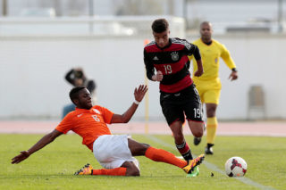 LAGOS, PORTUGAL - FEBRUARY 5: xxx of Netherlands challenges xxx of Germany during the UEFA Under17 match between U17 Netherlands v U17 Germany on February 5, 2016 in Vila Real de Santo Antonio, Portugal. (Photo by Filipe Farinha/Bongarts/Getty Images)