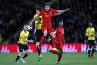 Liverpool's English midfielder Adam Lallana vies with Watford's Dutch defender Daryl Janmaat (2nd L) during the English Premier League football match between Watford and Liverpool at Vicarage Road Stadium in Watford, north of London on May 1, 2017. Liverpool won the game 1-0. / AFP PHOTO / Adrian DENNIS / RESTRICTED TO EDITORIAL USE. No use with unauthorized audio, video, data, fixture lists, club/league logos or 'live' services. Online in-match use limited to 75 images, no video emulation. No use in betting, games or single club/league/player publications.  /