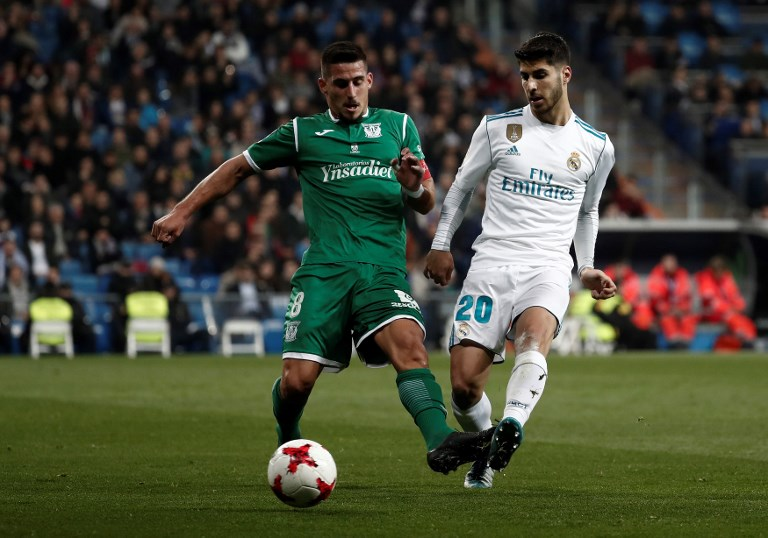MADRID, SPAIN - JANUARY 25: Marco Asensio (R) of Real Madrid in action against Gabriel (L) of Leganes during the Copa del Rey quarter final match between Real Madrid and Leganes at the Santiago Bernabeu Stadium in Madrid, Spain on January 25, 2018. Burak Akbulut / Anadolu Agency