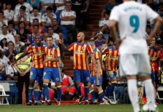 MADRID, SPAIN - AUGUST 27: Geoffrey Kondogbia (L) of Valencia celebrates with his teammates after scoring during the La Liga soccer match between Real Madrid and Valencia at Santiago Bernabeu in Madrid, Spain on August 27, 2017. Burak Akbulut / Anadolu Agency