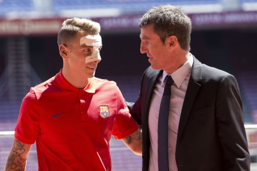 BARCELONA, SPAIN - JULY 14 :  FC Barcelona's new French defender Lucas Digne (R) attends his presentation with club's technical manager, Robert Fernandez (L) at Camp Nou Stadium in Barcelona, Spain on July 14, 2016. Albert Llop / Anadolu Agency