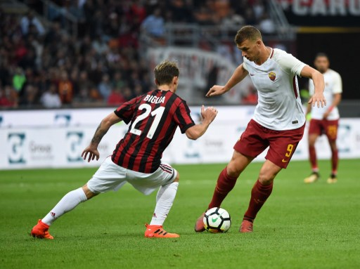 MILAN, ITALY - OCTOBER 1: (From L to R) Lucas Biglia of AC Milan  competes for the ball with Edin Dzeko of AS Roma during the Serie A 2017/18 match between AC Milan and AS Roma at Stadio Giuseppe Meazza on October 1, 2017 in Milan, Italy.  Pier Marco Tacca / Anadolu Agency