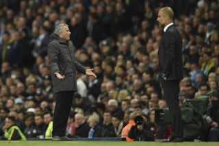 Manchester United's Portuguese manager Jose Mourinho (L) gestures on the touchline next to Manchester City's Spanish manager Pep Guardiola (R) during the English Premier League football match between Manchester City and Manchester United at the Etihad Stadium in Manchester, north west England, on April 27, 2017. / AFP PHOTO / Oli SCARFF / RESTRICTED TO EDITORIAL USE. No use with unauthorized audio, video, data, fixture lists, club/league logos or 'live' services. Online in-match use limited to 75 images, no video emulation. No use in betting, games or single club/league/player publications.  /