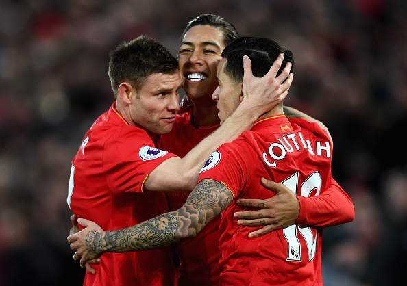 LIVERPOOL, ENGLAND - MARCH 04:  Roberto Firmino of Liverpool (C) celebrates scoring his sides first goal with James Milner of Liverpool (L) and Philippe Coutinho of Liverpool (R) during the Premier League match between Liverpool and Arsenal at Anfield on March 4, 2017 in Liverpool, England.  (Photo by Laurence Griffiths/Getty Images)