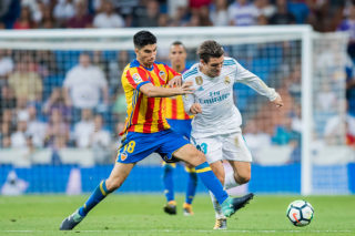 MADRID, SPAIN - AUGUST 27: Mateo Kovacic (r) of Real Madrid fights for the ball with Carlos Soler Barragan of Valencia CF during their La Liga 2017-18 match between Real Madrid and Valencia CF at the Estadio Santiago Bernabeu on 27 August 2017 in Madrid, Spain. (Photo by Power Sport Images/Getty Images)
