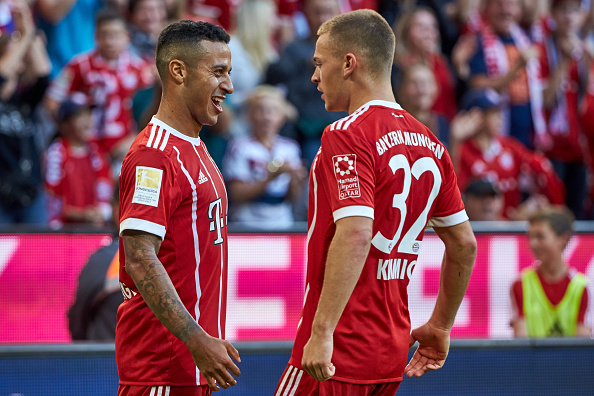 MUNICH, GERMANY - OCTOBER 14: Thiago of Bayern Muenchencelebrates after scoring his team`s third goal with team mates Joshua Kimmich of Bayern Muenchen during the Bundesliga soccer match between FC Bayern Munich and SC Freiburg at Allianz Arena in Munich, Germany on October 14, 2017. (Photo by TF-Images/TF-Images via Getty Images)