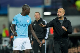 ROTTERDAM, NETHERLANDS - SEPTEMBER 13: Benjamin Mendy of Manchester City and Head coach Pep Guardiola of Manchester City looks on during the UEFA Champions League match between Feyenoord Rotterdam and Manchester City at Stadion Feijenoord on September 13, 2017 in Rotterdam, Netherlands. (Photo by TF-Images/TF-Images via Getty Images)