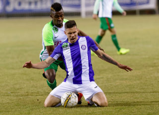 BUDAPEST, HUNGARY - MARCH 4: Amadou Moutari (L) of Ferencvarosi TC fouls Benjamin Balazs (R) of Ujpest FC during the Hungarian OTP Bank Liga match between Ujpest FC and Ferencvarosi TC at Ferenc Szusza Stadium on March 4, 2017 in Budapest, Hungary. (Photo by Laszlo Szirtesi/Getty Images)