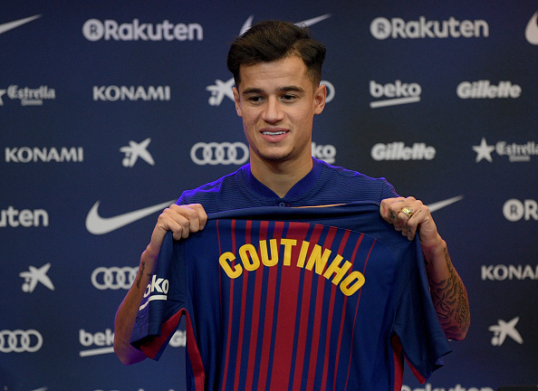 BARCELONA, SPAIN - JANUARY 08:  New Barcelona signing Philippe Coutinho poses for a photograph with his new shirt as he is unveiled at Camp Nou on January 8, 2018 in Barcelona, Spain. The Brazilian player signed from Liverpool, has agreed a deal with the Catalan club until 2023 season.  (Photo by David Ramos/Getty Images)
