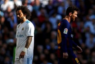 """Real Madrid's Brazilian defender Marcelo (L) and Barcelona's Argentinian forward Lionel Messi (R) react during the Spanish League """"Clasico"""" football match Real Madrid CF vs FC Barcelona at the Santiago Bernabeu stadium in Madrid on December 23, 2017.  / AFP PHOTO / OSCAR DEL POZO"""