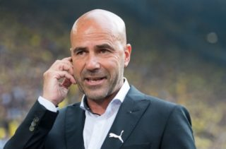 Dortmund's head coach Peter Bosz can be seen before the Bundesliga soccer match between Borussia Dortmund and Hertha BSC at the Signal Iduna Park in Dortmund, Germany, 26 August 2017.  (EMBARGO CONDITIONS - ATTENTION: Due to the accreditation guidlines, the DFL only permits the publication and utilisation of up to 15 pictures per match on the internet and in online media during the match.) Photo: Guido Kirchner/dpa