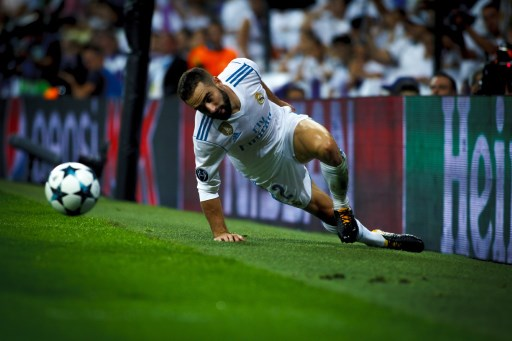 MADRID, SPAIN - SEPTEMBER 13: Daniel Carvajal of Real Madrid in action during the UEFA Champions League match between Real Madrid and Apoel, at Santiago Bernabeu Stadium in Madrid on September 13, 2017.  Guillermo Martinez / Anadolu Agency