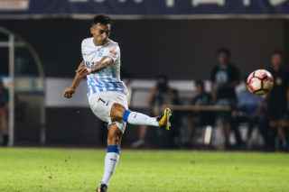 Israeli football player Eran Zahavi of Guangzhou R&F kicks the ball to make a shoot against Beijing Sinobo Guoan in their 25th round match during the 2017 Chinese Football Association Super League (CSL) in Guangzhou city, south China's Guangdong province, 16 September 2017.