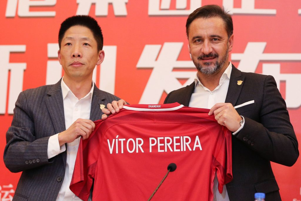 Shanghai SIPG's newly appointed coach Vitor Pereira (R) holds a jersey with beside Zhang Min (L), Chairman of Shanghai SIPG, during a press conference in Shanghai on December 12, 2017. Shanghai SIPG unveiled former Porto and Fenerbahce boss Vitor Pereira as their new coach on December 12, after fellow Portuguese Andre Villas-Boas left the big-spending Chinese Super League (CSL) side. / AFP PHOTO / - / China OUT